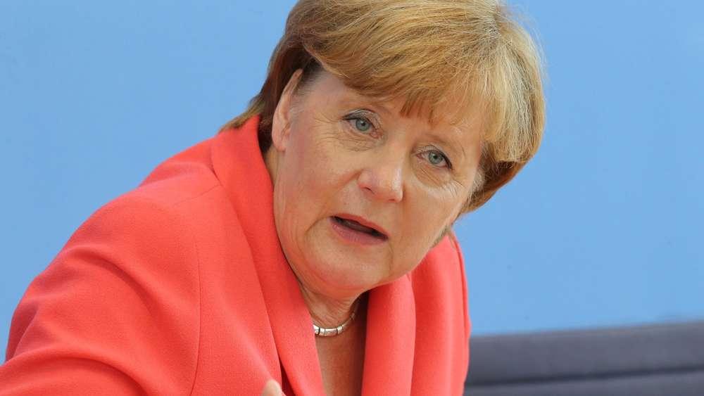 <b>Angela Merkel</b> - 413499201-angela-merkel-WZmecFpCANG