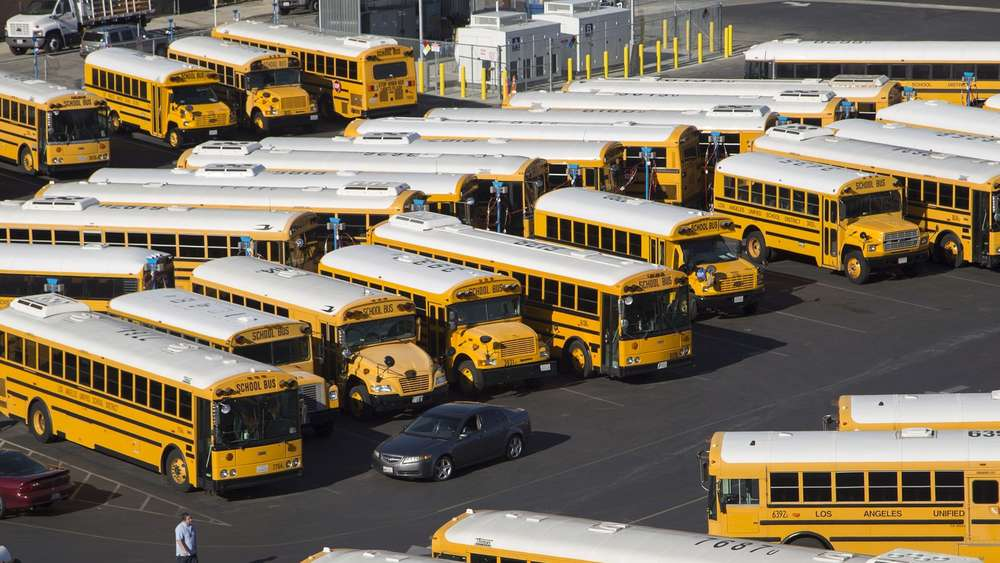 LOS ANGELES, CA - DECEMBER 15: School buses stand idle as all Los Angeles city schools are shut down in reaction to a threat on December 15, 2015 in Los Angeles, California. A bomb threat against LAUSD schools was sent to various members of the Los Angeles school board late last night, according to LAPD Chief Charlie Beck. Local authorities immediately notified the FBI. David McNew/Getty Images/AFP== FOR NEWSPAPERS, INTERNET, TELCOS & TELEVISION USE ONLY ==