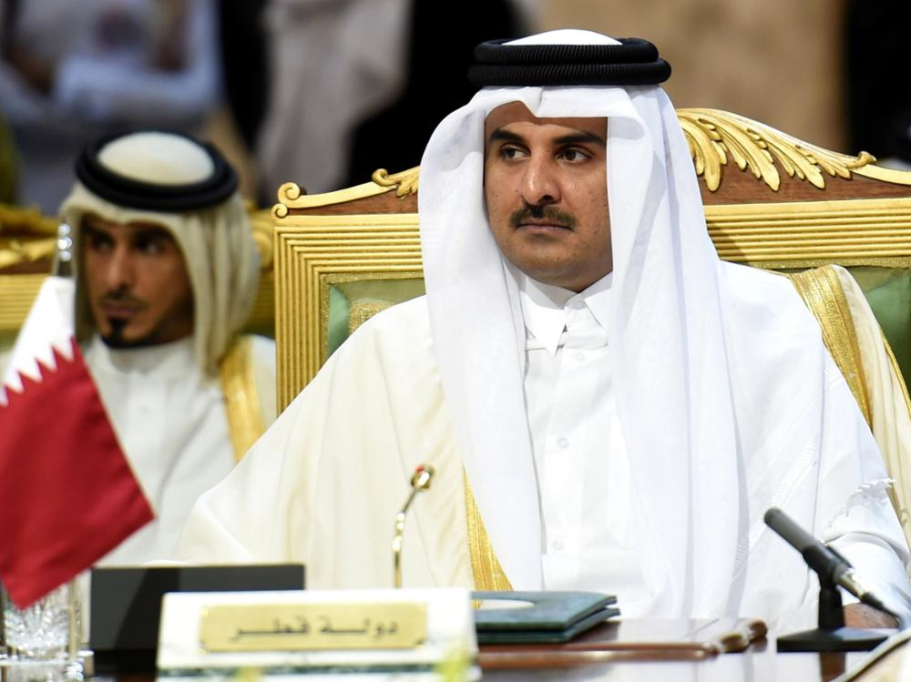 "Qatar's Emir Sheikh Tamim bin Hamad Al-Thani attends the second day of the 136th Gulf Cooperation Council (GCC) summit held in Riyadh, on December 10, 2015 as kings and emirs from six Gulf states began two days of talks, at the same time as unprecedented discussions by the Syrian opposition at a luxury hotel in another part of the city. Saudi King Salman bin Abdulaziz called for political solutions to the wars in Syria and Yemen, while condemning ""terrorism,"" at the opening of the annual Gulf summit. AFP PHOTO / FAYEZ NURELDINE"
