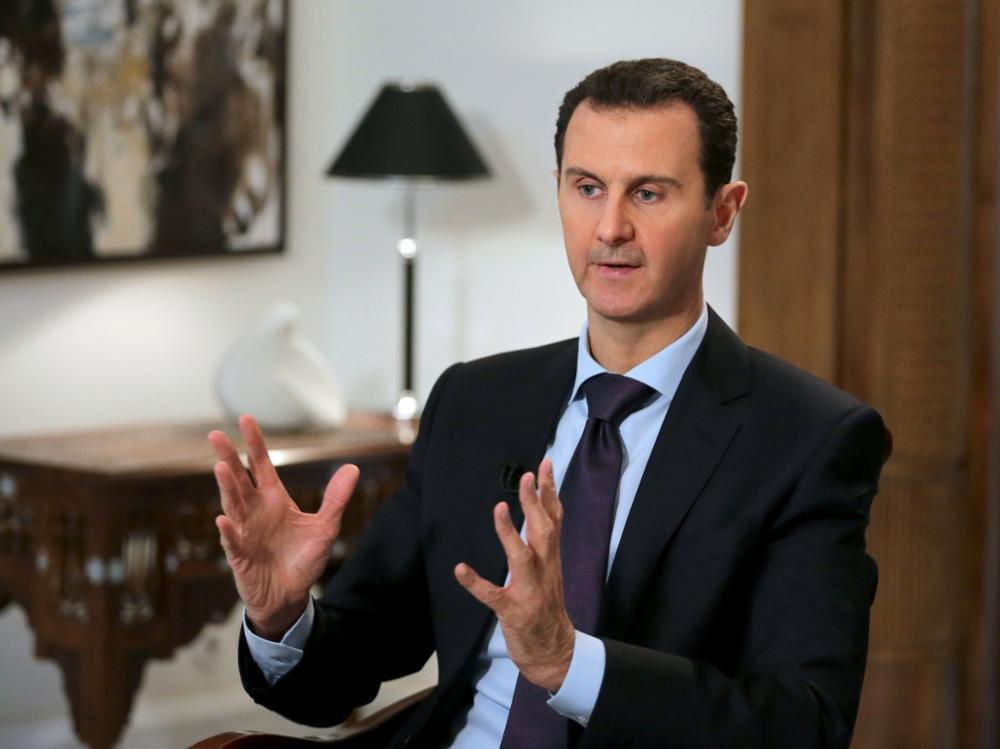 (FILES) This file photo taken on February 11, 2016 shows Syrian President Bashar al-Assad during an exclusive interview with AFP in the capital Damascus.Syria's civil war, which has killed more than 270,000 people and forced millions to flee their homes, erupted in 2011 when government forces turned their weapons on protesters demanding political change. / AFP PHOTO / JOSEPH EID