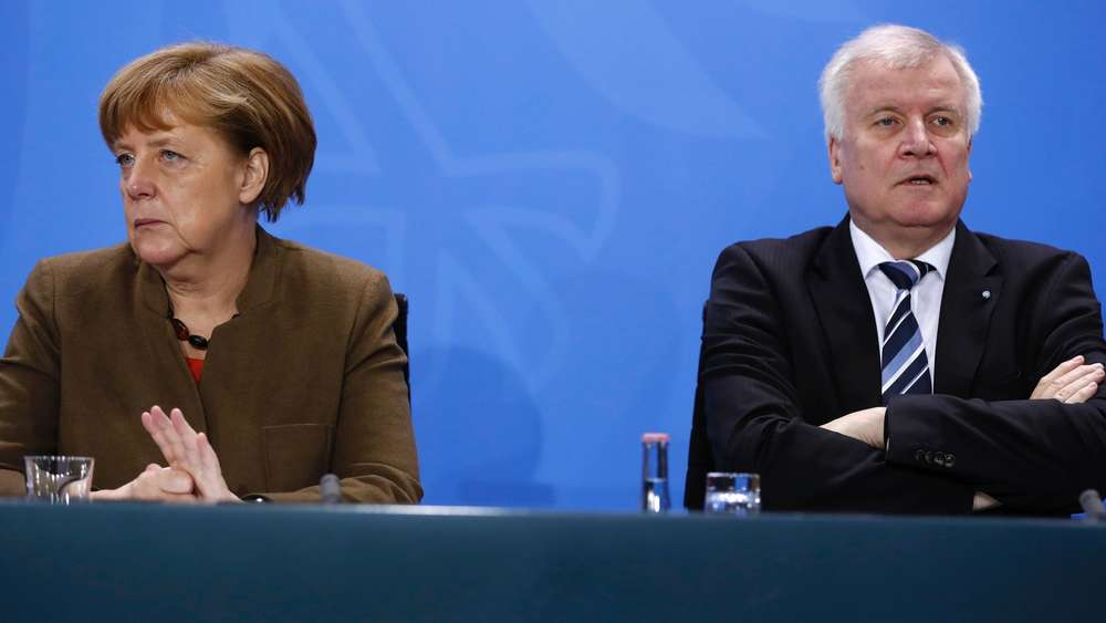 German Chancellor Angela Merkel (L) and Bavarian state premier and leader of the conservative Christian Social Union (CSU) Horst Seehofer give a press conference on April 14, 2016 at the Chancellery in Berlin.German Chancellor Angela Merkel&#39s ruling coalition agreed on tough measures to spur the integration of migrants and refugees, including sanctions for failing to take part in programmes such as language classes. / AFP PHOTO / ODD ANDERSEN