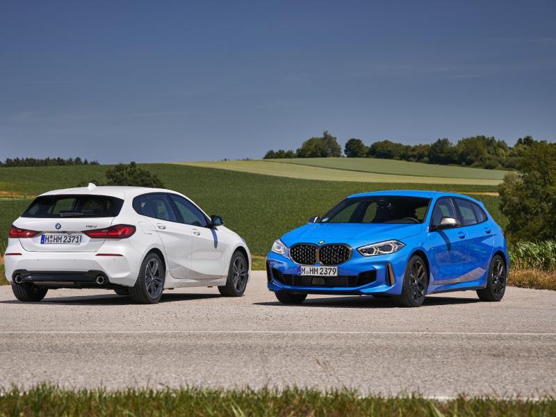 Alle neuen BMW 1er wie etwa BMW 118d und M135i (rechts) fahren mit Frontantrieb. Foto: Tom Kirkpatrick/BMW
